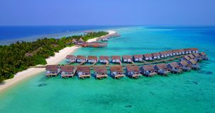 V03723 Aerial flying drone view of Maldives white sandy beach on sunny tropical paradise island with aqua blue sky sea Stock Images