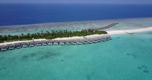 V03665 Aerial flying drone view of Maldives white sandy beach on sunny tropical paradise island with aqua blue sky sea Royalty Free Stock Photography