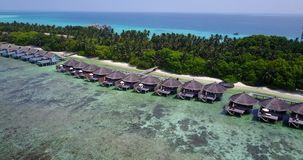 V03551 Aerial flying drone view of Maldives white sandy beach on sunny tropical paradise island with aqua blue sky sea Stock Image