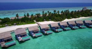 V03641 Aerial flying drone view of Maldives white sandy beach on sunny tropical paradise island with aqua blue sky sea Stock Images