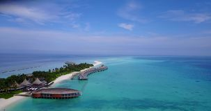 V03738 Aerial flying drone view of Maldives white sandy beach on sunny tropical paradise island with aqua blue sky sea Royalty Free Stock Images