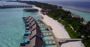 V03581 Aerial flying drone view of Maldives white sandy beach on sunny tropical paradise island with aqua blue sky sea Royalty Free Stock Photo