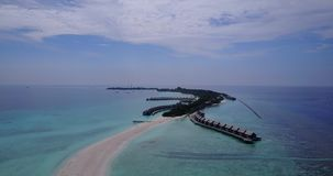 V03532 Aerial flying drone view of Maldives white sandy beach on sunny tropical paradise island with aqua blue sky sea Royalty Free Stock Image