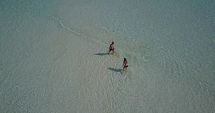 V03809 Aerial flying drone view of Maldives white sandy beach on sunny tropical paradise island with aqua blue sky sea Royalty Free Stock Photo
