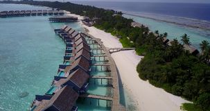 V03575 Aerial flying drone view of Maldives white sandy beach on sunny tropical paradise island with aqua blue sky sea Royalty Free Stock Image