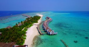V03725 Aerial flying drone view of Maldives white sandy beach on sunny tropical paradise island with aqua blue sky sea Royalty Free Stock Photography