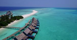 V03583 Aerial flying drone view of Maldives white sandy beach on sunny tropical paradise island with aqua blue sky sea Royalty Free Stock Photo