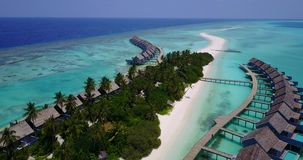 V03534 Aerial flying drone view of Maldives white sandy beach on sunny tropical paradise island with aqua blue sky sea Royalty Free Stock Photography