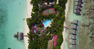 V03560 Aerial flying drone view of Maldives white sandy beach on sunny tropical paradise island with aqua blue sky sea Stock Photos