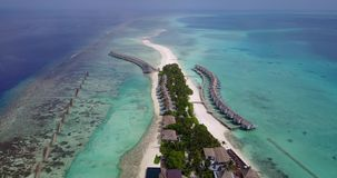 V03606 Aerial flying drone view of Maldives white sandy beach on sunny tropical paradise island with aqua blue sky sea Stock Photos