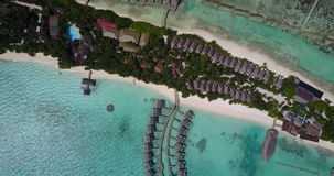 V03619 Aerial flying drone view of Maldives white sandy beach on sunny tropical paradise island with aqua blue sky sea Stock Image