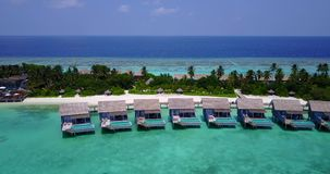 V03740 Aerial flying drone view of Maldives white sandy beach on sunny tropical paradise island with aqua blue sky sea Stock Photography
