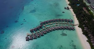 V03698 Aerial flying drone view of Maldives white sandy beach on sunny tropical paradise island with aqua blue sky sea Stock Image
