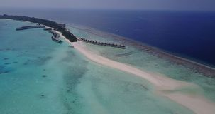 V03803 Aerial flying drone view of Maldives white sandy beach on sunny tropical paradise island with aqua blue sky sea Royalty Free Stock Photos
