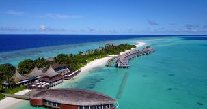 V03770 Aerial flying drone view of Maldives white sandy beach on sunny tropical paradise island with aqua blue sky sea Stock Images