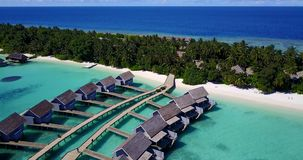 V03780 Aerial flying drone view of Maldives white sandy beach on sunny tropical paradise island with aqua blue sky sea Royalty Free Stock Image