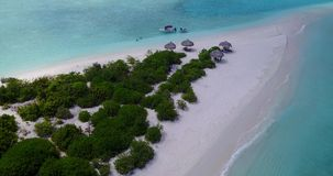 V03567 Aerial flying drone view of Maldives white sandy beach on sunny tropical paradise island with aqua blue sky sea Stock Images