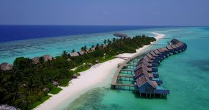 V03636 Aerial flying drone view of Maldives white sandy beach on sunny tropical paradise island with aqua blue sky sea Royalty Free Stock Photos