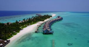 V03722 Aerial flying drone view of Maldives white sandy beach on sunny tropical paradise island with aqua blue sky sea Stock Images