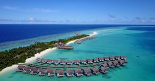 V03768 Aerial flying drone view of Maldives white sandy beach on sunny tropical paradise island with aqua blue sky sea Stock Image