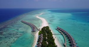 V03546 Aerial flying drone view of Maldives white sandy beach on sunny tropical paradise island with aqua blue sky sea Stock Image
