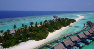 V03673 Aerial flying drone view of Maldives white sandy beach on sunny tropical paradise island with aqua blue sky sea Royalty Free Stock Photography