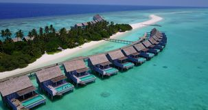 V03724 Aerial flying drone view of Maldives white sandy beach on sunny tropical paradise island with aqua blue sky sea Royalty Free Stock Photos