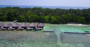V03547 Aerial flying drone view of Maldives white sandy beach on sunny tropical paradise island with aqua blue sky sea Royalty Free Stock Photos