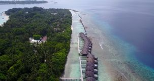 V03585 Aerial flying drone view of Maldives white sandy beach on sunny tropical paradise island with aqua blue sky sea Stock Photography