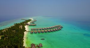 V03787 Aerial flying drone view of Maldives white sandy beach on sunny tropical paradise island with aqua blue sky sea Stock Image