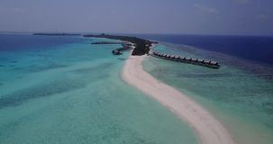 V03669 Aerial flying drone view of Maldives white sandy beach on sunny tropical paradise island with aqua blue sky sea Stock Image
