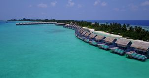 V03691 Aerial flying drone view of Maldives white sandy beach on sunny tropical paradise island with aqua blue sky sea Royalty Free Stock Images