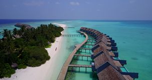 V03561 Aerial flying drone view of Maldives white sandy beach on sunny tropical paradise island with aqua blue sky sea Royalty Free Stock Image