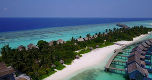 V03721 Aerial flying drone view of Maldives white sandy beach on sunny tropical paradise island with aqua blue sky sea Royalty Free Stock Photo