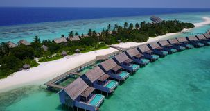 V03710 Aerial flying drone view of Maldives white sandy beach on sunny tropical paradise island with aqua blue sky sea Royalty Free Stock Images
