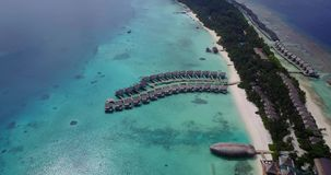 V03540 Aerial flying drone view of Maldives white sandy beach on sunny tropical paradise island with aqua blue sky sea Royalty Free Stock Images