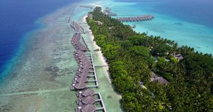 V03701 Aerial flying drone view of Maldives white sandy beach on sunny tropical paradise island with aqua blue sky sea Royalty Free Stock Image