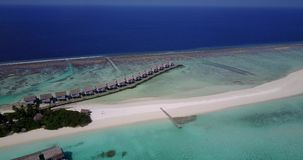 V03549 Aerial flying drone view of Maldives white sandy beach on sunny tropical paradise island with aqua blue sky sea Royalty Free Stock Photos