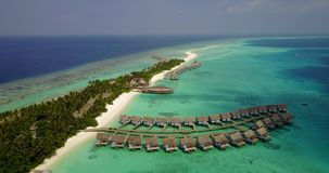 V03712 Aerial flying drone view of Maldives white sandy beach on sunny tropical paradise island with aqua blue sky sea Stock Image