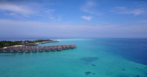 V03642 Aerial flying drone view of Maldives white sandy beach on sunny tropical paradise island with aqua blue sky sea Stock Photography