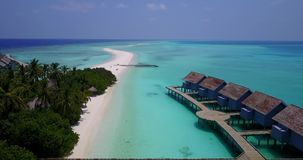 V03741 Aerial flying drone view of Maldives white sandy beach on sunny tropical paradise island with aqua blue sky sea Royalty Free Stock Photo
