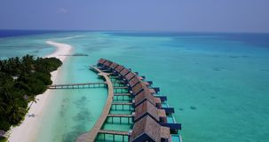 V03658 Aerial flying drone view of Maldives white sandy beach on sunny tropical paradise island with aqua blue sky sea Royalty Free Stock Image