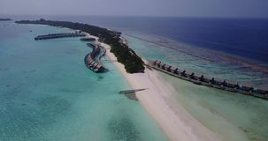 V03538 Aerial flying drone view of Maldives white sandy beach on sunny tropical paradise island with aqua blue sky sea Stock Photography
