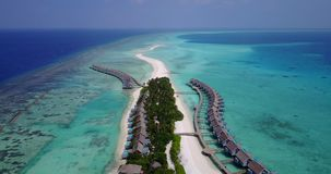 V03696 Aerial flying drone view of Maldives white sandy beach on sunny tropical paradise island with aqua blue sky sea Royalty Free Stock Photography