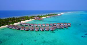 V03731 Aerial flying drone view of Maldives white sandy beach on sunny tropical paradise island with aqua blue sky sea Royalty Free Stock Photo