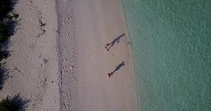 V03812 Aerial flying drone view of Maldives white sandy beach on sunny tropical paradise island with aqua blue sky sea stock footage