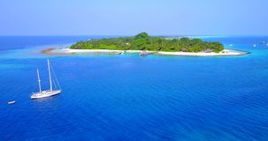V03158 Aerial flying drone view of Maldives white sandy beach on sunny tropical paradise island with aqua blue sky sea stock video footage