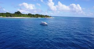 V03240 Aerial flying drone view of Maldives white sandy beach on sunny tropical paradise island with aqua blue sky sea stock video