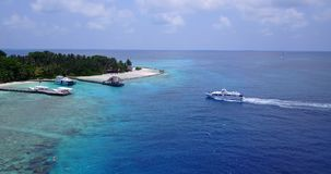 V03347 Aerial flying drone view of Maldives white sandy beach on sunny tropical paradise island with aqua blue sky sea stock video