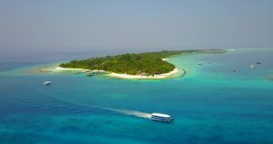 V03052 Aerial flying drone view of Maldives white sandy beach on sunny tropical paradise island with aqua blue sky sea stock video footage